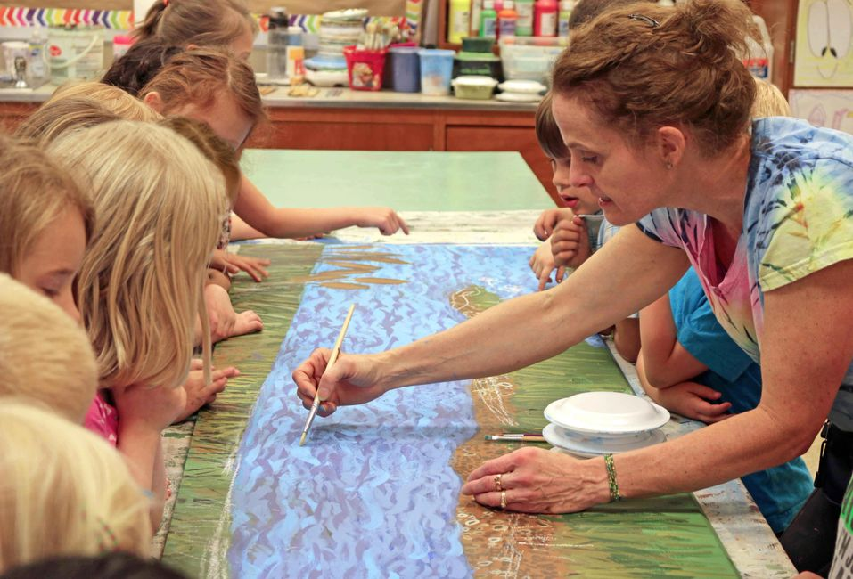 Cape St. Claire Elementary students work with artist Gayle Mangan Kassal to create a mural