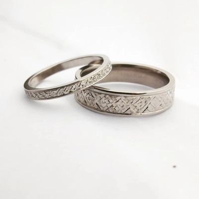 Platinum wedding bands, hand engraved with a traditional Polish pattern.