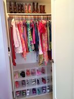 Visually appealing, functional, shared childrens' closet for 2 kids