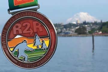 Custom race medal for Rainier to Ruston Ultra Run featuring stained glass inserts.