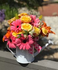 Bold flowers in a watering can.  Free no contact delivery! Limited time special. Flowers subject to