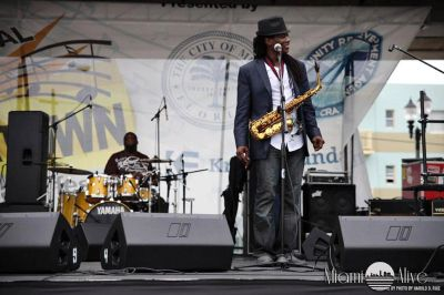 Smooth jazz saxophonist Earnest Walker Jr smiles on stage at the Overtown Music Festival in Miami, FL