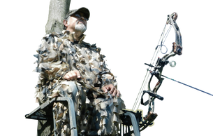 Hunter in a tree stand sitting with a Bow in a Bow Holder, easy to reach and ready to hunt
