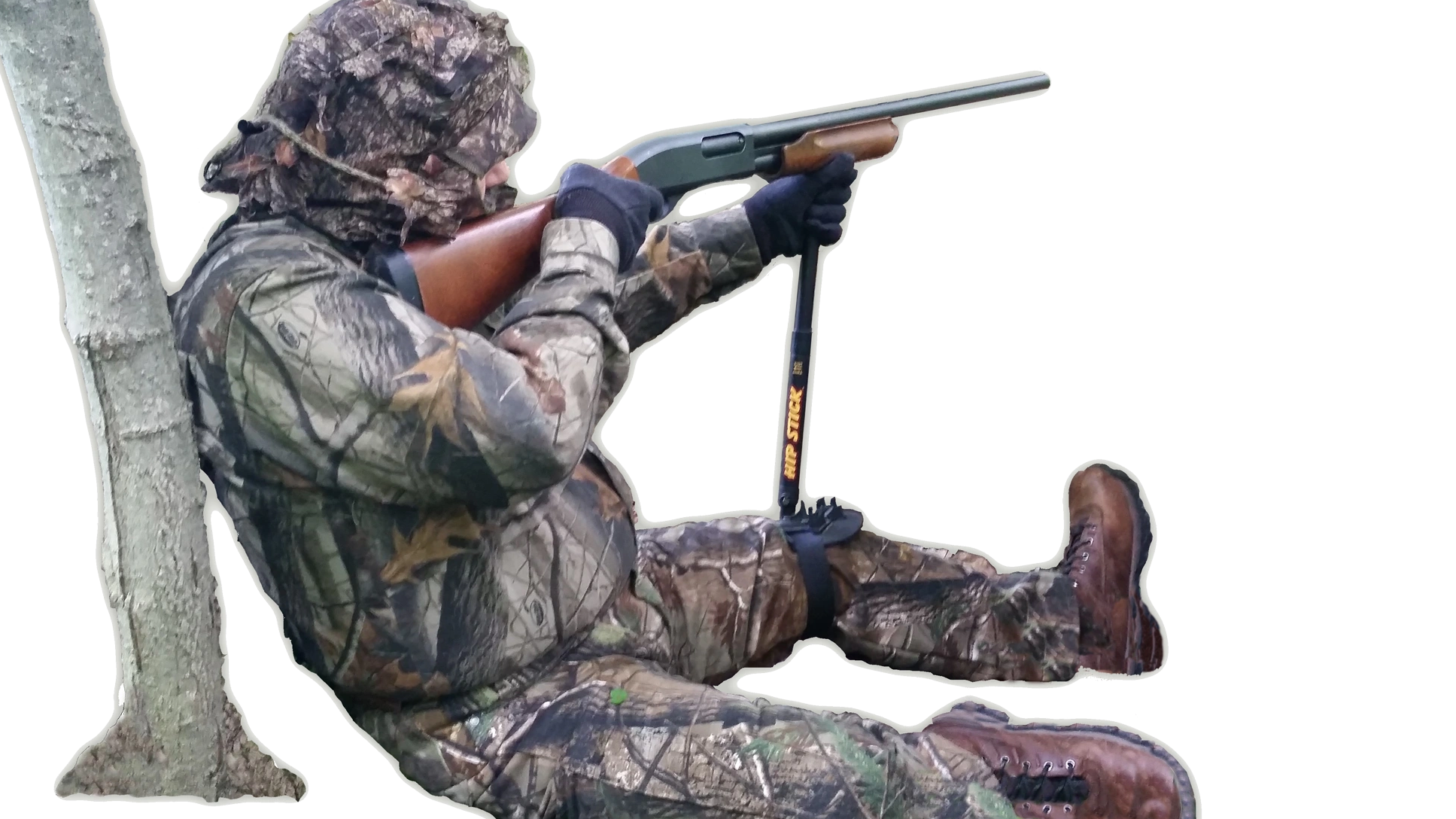 Turkey hunter sitting on the ground steadying a shotgun with a Hip Stick Shooting Rest on his knee