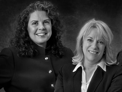 Attorneys Laura K. Fretland & Lori McLaughlin of Dove Fretland Law