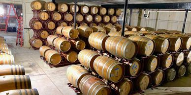 Barrels of wine, stacked in the barrel aging cellar.