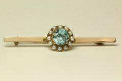 Gold aquamarine and seed pearl stock pin