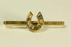 Gold sapphire and diamond stock pin