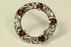 Silver and garnet stock pin