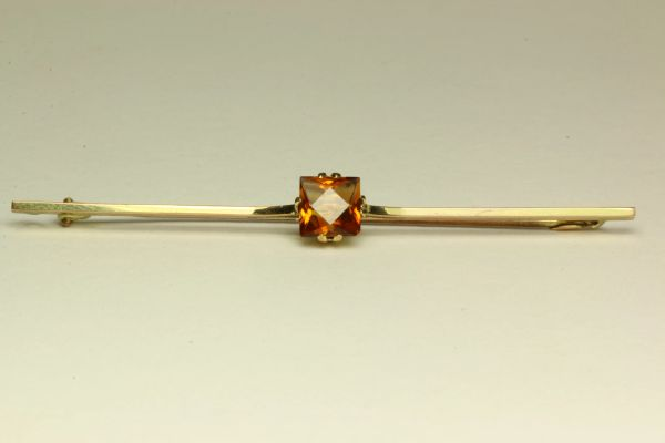 Gold and citrine stock pin
