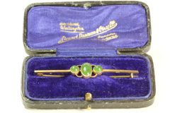 Gold and jade stock pin