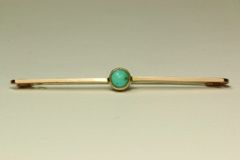 Gold and turquoise stock pin