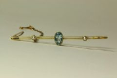 Gold aquamarine and seed pearl stock pin