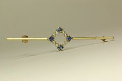 Gold sapphire and seed pearl stock pin