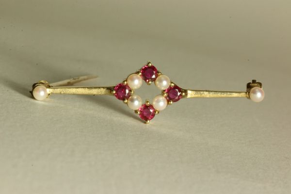Gold ruby and pearl stock pin