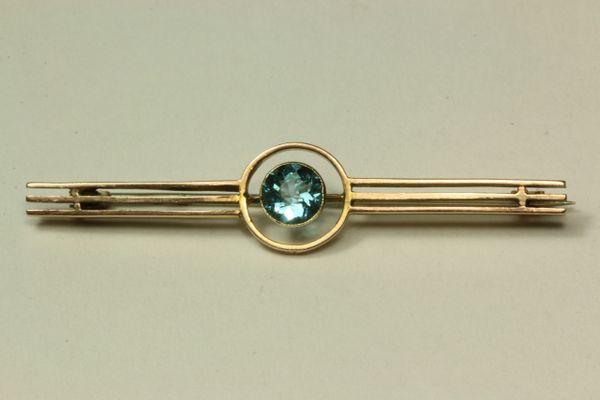 Gold and aquamarine stock pin