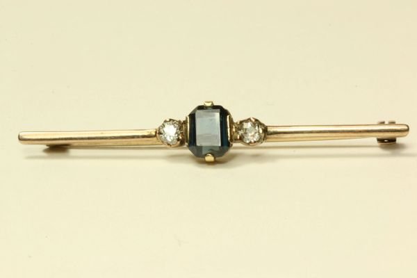 Gold diamond and sapphire stock pin