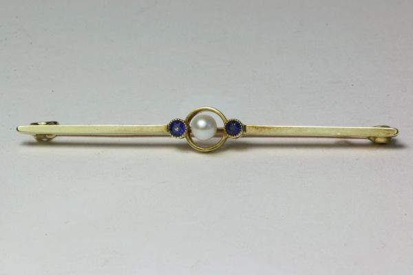 Gold sapphire and pearl stock pin