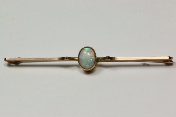 Gold and opal stock pin