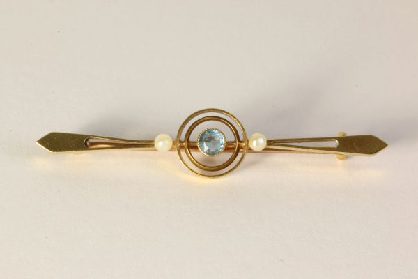 Gold zircon and pearl stock pin