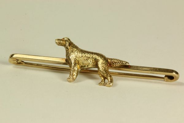 Gold dog stock pin