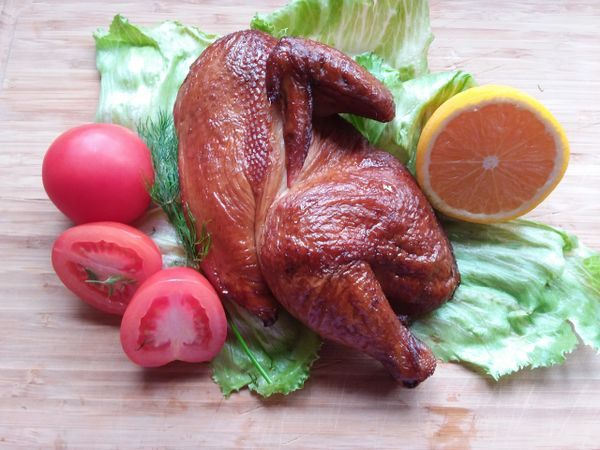 Half portion oak-smoked and ready-cooked straight-from-the-farm spatchcocked premium chicken