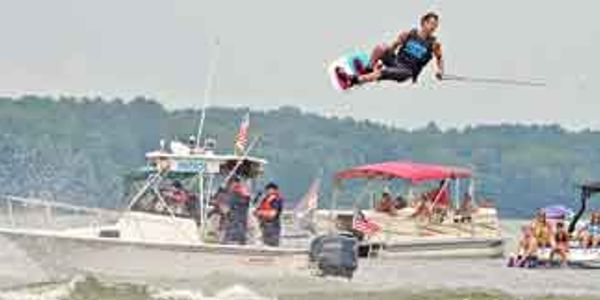 World Champion Adam Fields wakeboarding on Lake Gaston during Lake Gaston Big Air Fair.