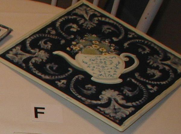 Metal tile with tea pot
