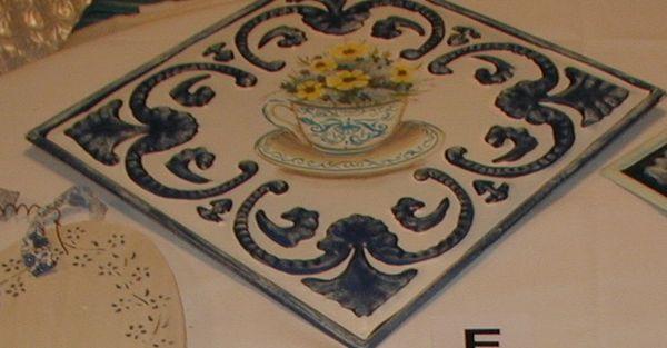Metal tile with tea cup