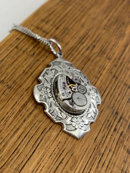 Silver Tone Floral Border Pendant with Vintage Elgin Oval Watch Movement