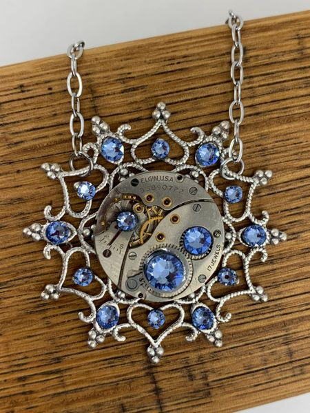 Silver tone Snowflake Pendant with Vintage Mechanical Watch Movement and Light Sapphire Swarovski Crystals
