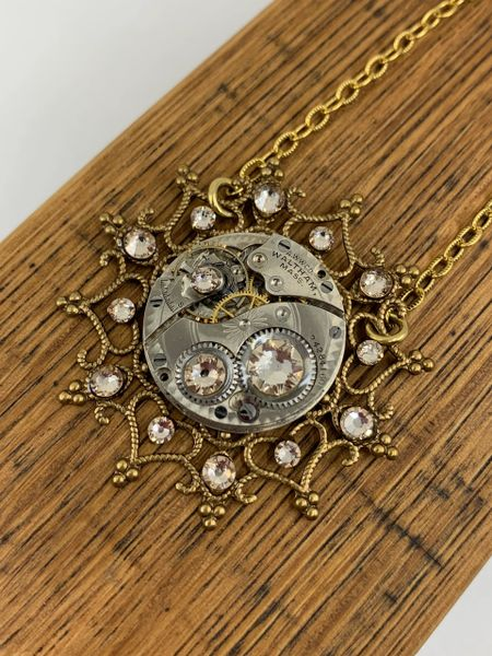 Brass Snowflake Necklace with Vintage Mechanical Watch Movement and Light Silk Swarovski Crystals