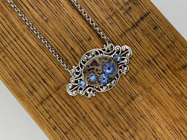 Small Silver Oval Filigree Necklace with Vintage Watch and Light Sapphire Swarovski Crystals