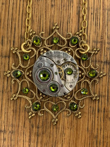 Brass Snowflake Necklace with Vintage Mechanical Watch Movement and Olivine Swarovski Crystals