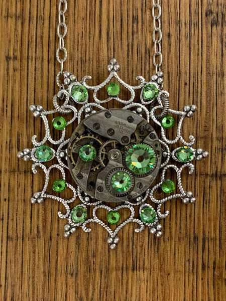 Silver Snowflake Necklace with Vintage Watch Movement and Light Green Swarovski Crystals