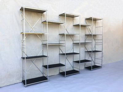 Portable collapsible bookcase, 10' long x 6' high x 1' deep natural aluminum with black shelf liners.  Portable shelf display