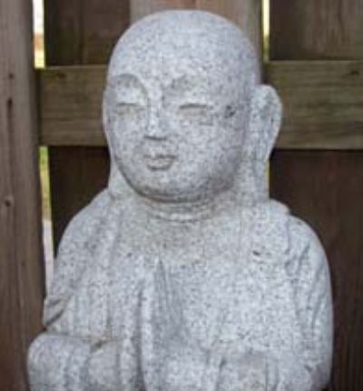 Jizo Bodhisattva statue sits outside of the Atlanta Dojo.