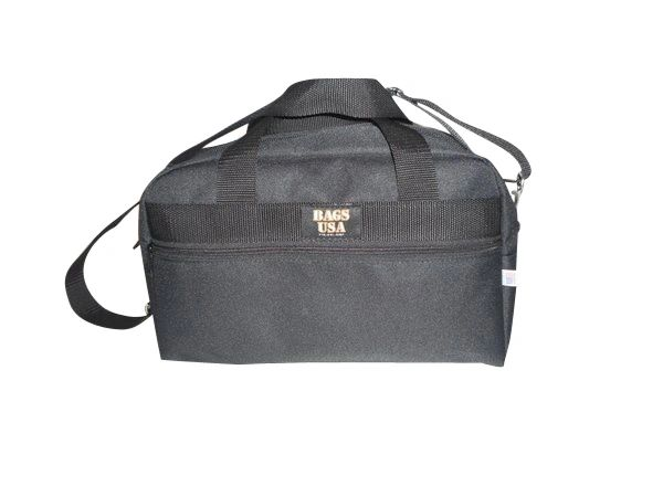 Cargo bag 15 inch wide has front pocket also slides over wheeled luggage handle.