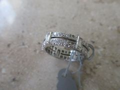 horizontal/vertical diamond ring