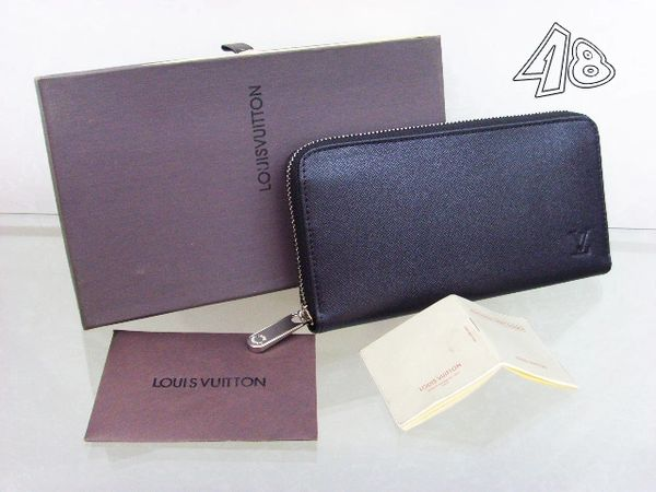 Ladies Louis Vuitton Solid Leather Epi Zippy Wallet