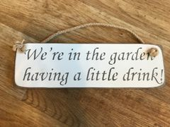 'We're in the Garden having a little drink!' Sign by Austin Sloan