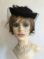 Vintage 1960s Black Handmade Polyester Calot Pillbox Hat With Face Net And Large Rear Feather Detail