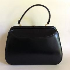 Black Soft Calf Leather 1950s Vintage Handbag With Bright Red Leather Lining and Gold Toned Fittings and Frame