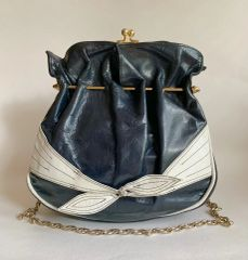 Vintage 1960s Dark Blue And White Leather Handbag Shoulder Bag With Gold Toned Chain Handle And White Tie Decoration To The Front.
