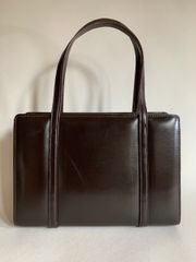 Vintage 1960s Brown Calf Leather Handbag With Brown Leather Lining And Pull Out Hidden Clasp With Vanity Mirror.