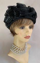 "Vintage 1960s Black Turban Style Stiff Swirl Polyester Hat 21"" Net Lined"