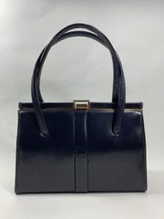 Dark Blue Small 1950s Leather Vintage Handbag With Blue Taffeta Fabric Lining And Vanity Mirror.