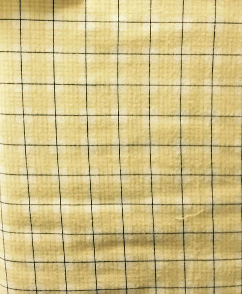 Light yellow plaid FLANNEL Fabric with dark stripe running through