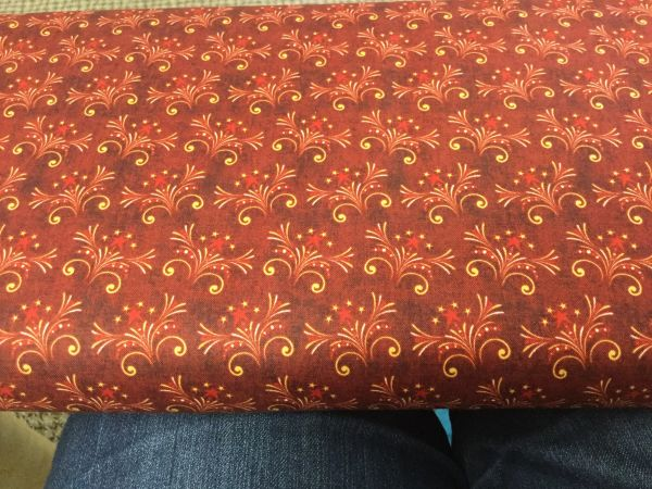 QT reddish burgundy fireworks fabric For Love of Country