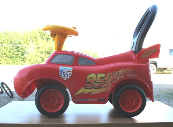 Disney Pixar CARS Toddler Ride and Push Toy with LIGHTS AND SOUNDS